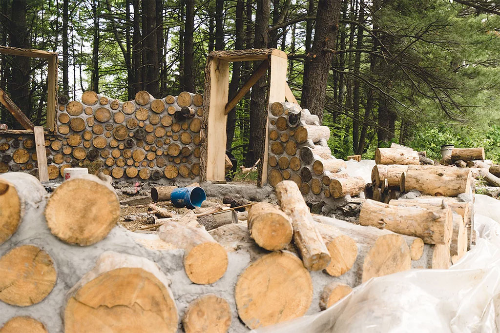 cord wood wall building new york forest farm